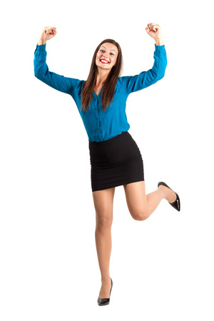 Excited happy business woman with raised leg and clenched fists. Full body length isolated over white background. photo
