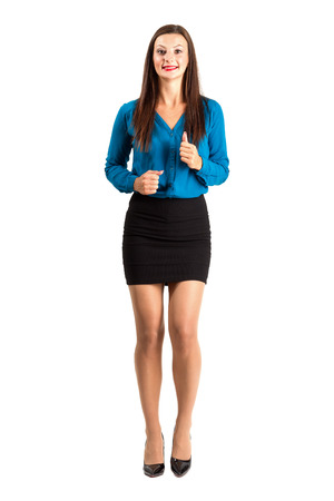 frontal view: Running business woman frontal view. Full body length isolated over white background.
