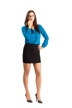 secretary skirt: Sensual pensive teacher with glasses looking up. Full body length isolated over white background. Stock Photo