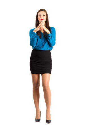 Serious business woman with aligned hands. Full body length isolated over white background. Stock Photo