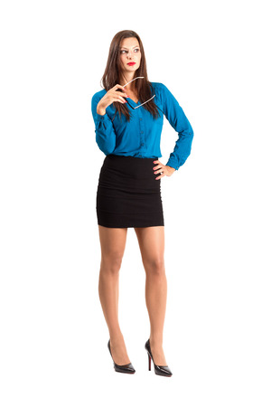 secretary skirt: Thinking business woman holding glasses looking away. Full body length isolated over white background.