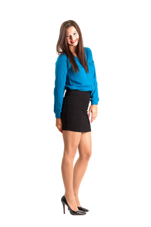 spontaneous: Spontaneous business woman smiling looking at camera. Full body length isolated over white background.