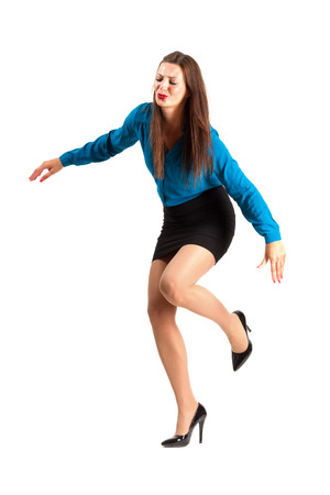 Tripping or falling business woman in high heels. Full body length isolated over white background.