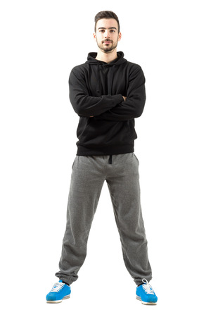 tracksuit: Young male with folded or crossed hands in the sportswear. Full body length isolated over white background.