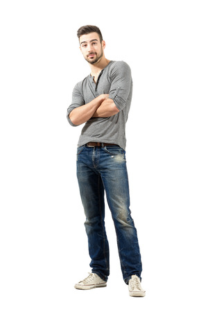 v neck: Confused man with crossed arms. Full body length isolated over white background.