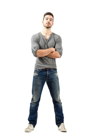 v neck: Young proud satisfied man with crossed arms looking at camera. Full body length isolated over white background. Stock Photo