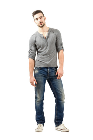 lean on hands: Relaxed young male model posing.  Full body length isolated over white background. Stock Photo