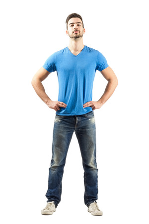 man arm: Confident proud young male in akimbo pose. Full body length isolated over white background. Stock Photo