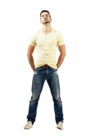tilted: Confident young latin man with head tilted back. Full body length portrait isolated over white background.