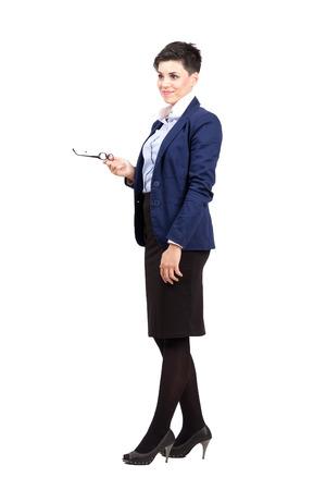 falda corta: Joven mujer de negocios lindo confundido mirando a otro lado. Cuerpo completo retrato de cuerpo entero aisladas sobre fondo blanco.