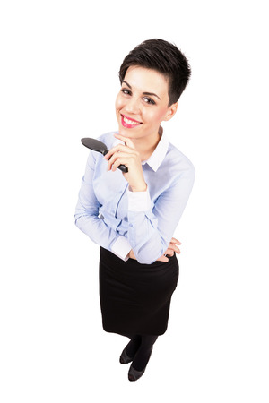 formal clothes: Young short hair woman in formal clothes smiling at camera. High angle view wide lens full body length portrait isolated over white background