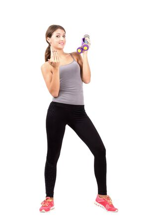 beckoning: Young sporty woman holding dumb bells beckoning at camera. Full body length portrait isolated over white background.