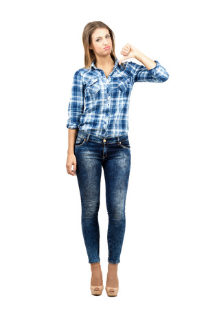 no heels: Beautiful disappointed female student with thumbs down gesture. Full body length portrait isolated over white background.