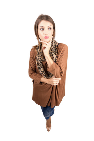 woman full body: Young pensive beauty looking away with finger on her chin. High angle view wide lens full body length portrait isolated over white background