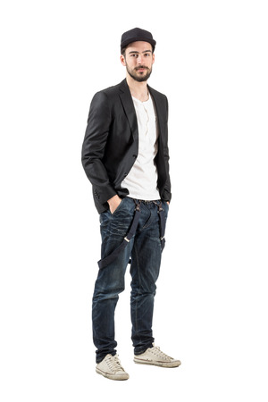 young man jeans: Stylish fashion model with baseball cap looking at camera. Full body length portrait isolated over white background. Stock Photo