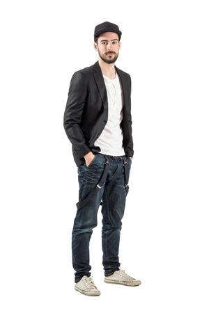 undercut: Stylish fashion model with baseball cap looking at camera. Full body length portrait isolated over white background. Stock Photo