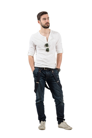 rolled up sleeves: Handsome young fashion model confident looking away. Full body length portrait isolated over white background. Stock Photo