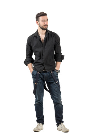 Young confident fashion model in black shirt looking away. Full body length portrait isolated over white background. photo
