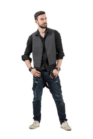 rolled up sleeves: Young trendy fashion male model looking at distance. Full body length portrait isolated over white background.