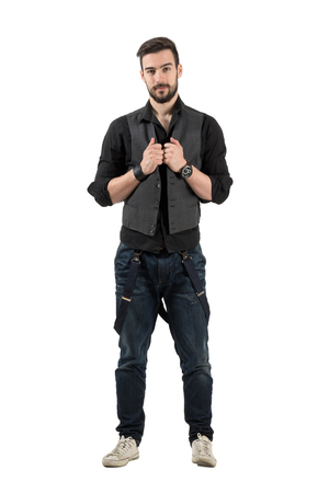rolled up sleeves: Young confident hipster holding his vest looking at camera. Full body length portrait isolated over white background.