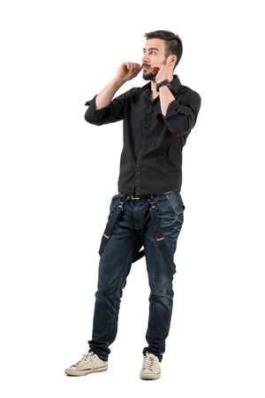 rolled up sleeves: Cool young fashion model adjusting his mustaches. Full body length portrait isolated over white background.
