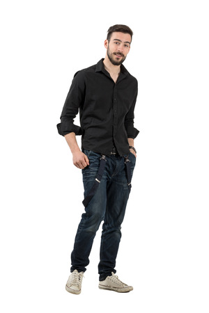 rolled up sleeves: Young man in black shirt with rolled up sleeves walking. Full body length portrait isolated over white background. Stock Photo