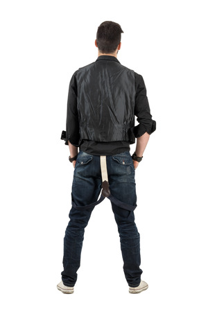 rolled up sleeves: Rear backside view of young stylish man looking at blank wall. Full body length portrait isolated over white background. Stock Photo