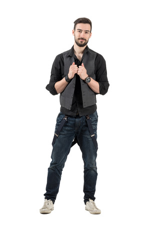rolled up sleeves: Smiling positive young man holding his vest looking at camera. Full body length portrait isolated over white background. Stock Photo