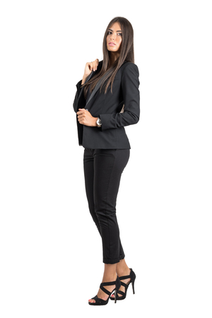 beauty full: Gorgeous business beauty in black jacket and pants posing at camera.  Full body length portrait isolated over white studio background.