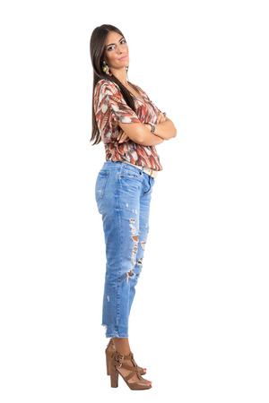 beauty full: Young confident Indian beauty posing with folded arms. Side view.  Full body length portrait isolated over white studio background.
