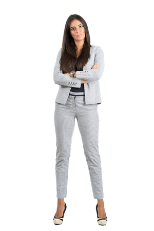 confident business woman: Confident strong business woman with folded arms looking at camera.  Full body length portrait isolated over white studio background.