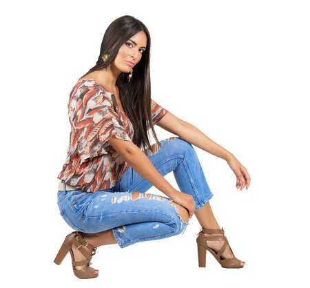camera girl: Sensual young brunette in casual clothes looking at camera. Full body length portrait isolated over white studio background. Stock Photo