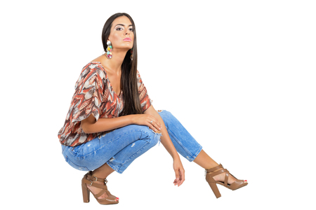 head back: Confident young tanned brunette fashion model posing in jeans with head back. Full body length portrait isolated over white studio background.