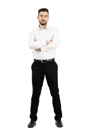 Young confident business man with crossed arms looking at camera. Full body length portrait isolated over white studio background. Stockfoto