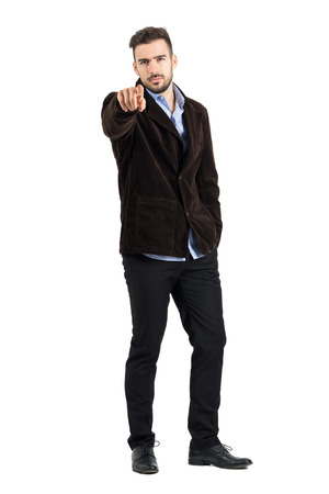 accusing: Angry manager pointing finger at camera accusing. Full body length portrait isolated over white studio background.