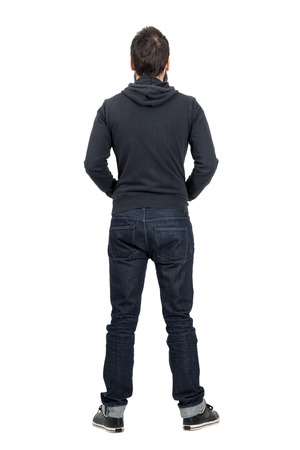 hooded shirt: Rear view of man in black hooded shirt with rolled up jeans. Full body length portrait isolated over white studio background.