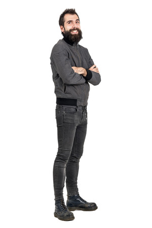 tight body: Funny laughing bearded man in tight jeans and army boots looking at camera. Full body length portrait isolated over white studio background.