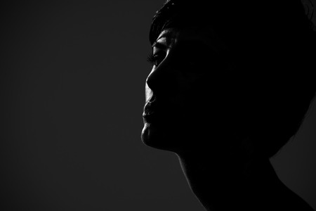 Abstract silhouette portrait of short hair woman looking at camera