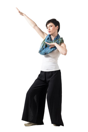 Playful short hair fashion model with colorful neckerchief in kung fu pose. Full body length portrait isolated over white studio background.
