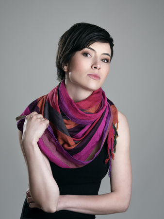Glamour portrait of pretty short hair beauty model with colorful neckerchief looking at camera.