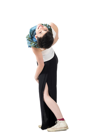 awkward: Awkward pose of young playful short hair woman bending backwards and looking at camera upside down. Full body length portrait isolated over white studio background.