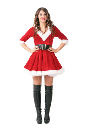 mrs santa claus: Straight front view of smiling merry Santa woman with arms on waist. Full body length portrait isolated over white studio background.