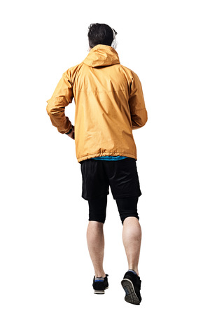 running pants: Back view of jogger in jacket running. Toned desaturated full body length portrait isolated on white studio background. Stock Photo
