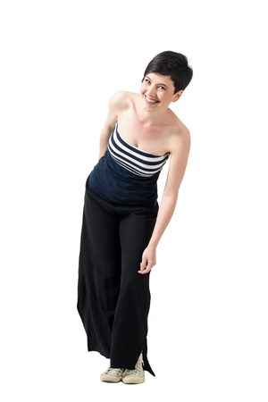 off shoulder: Trendy young short hair woman in wide-leg pants leaning and laughing. Full body length portrait isolated over white studio background.