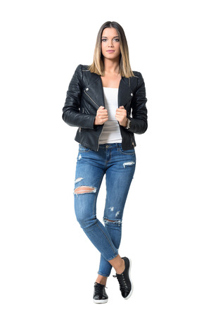 Confident gorgeous girl in torn jeans with ombre hairstyle posing and looking at camera. Full body length portrait isolated over studio white background.