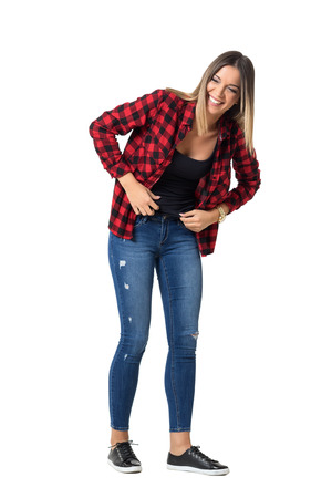 Bend young pretty woman in casual clothes laughing loudly. Full body length standing portrait isolated over white background. Stock Photo