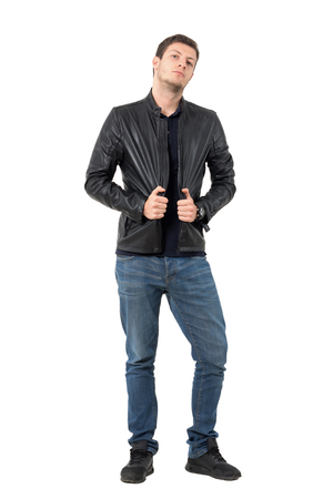 isolated man: Young casual man posing and pulling leather jacket collar. Full body length portrait isolated over white background.