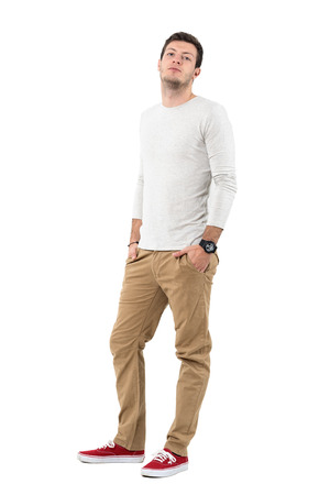 tilted view: Relaxed young stylish man in long sleeved shirt with head tilted back. Full body length portrait isolated over white studio background.