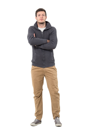 Confident young successful casual man in jumper with crossed arms. Full body length portrait isolated over white background. Stock Photo
