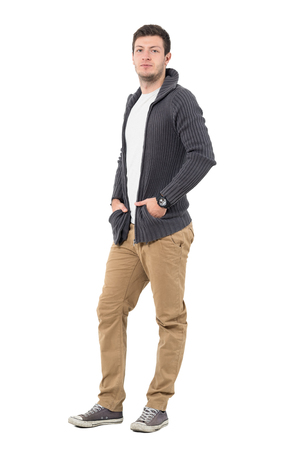 Confident casual man wearing sweater jacket looking at camera. Full body length portrait isolated over white background.